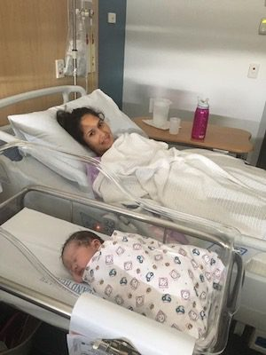 New mum Gemma and Baby resting