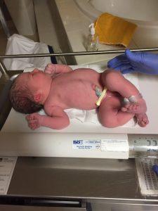 Newborn baby being weighed