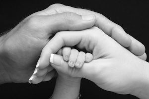 Image of mothers, fathers and babies hand