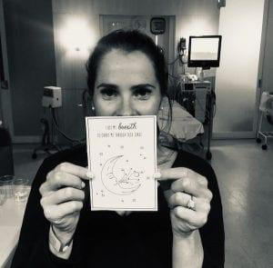 Morgnanholding a positive affirmation card
