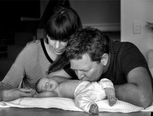 Olga, Simon kissing baby Minerva
