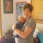 Hypnobirthing Mum Emma Standing holding her newborn baby